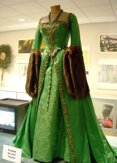 Green Tudor era gown with fur sleeves