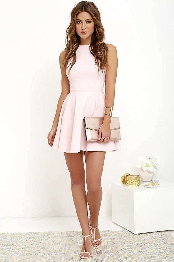 With numbers of events on the agenda, this grandiose minimal pink sleeveless short skater dress featuring crew neckline carry you through each outing with elegance!The soft fabric falls from a classic..