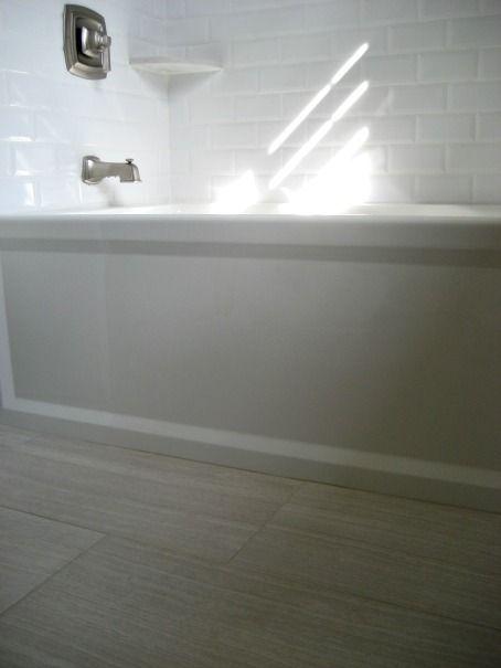 This is the tub I want -- also like the tile...  Kohler Archer tub, Florim Stratos Avorio 12x24 porcelain floor tile, beveled white subway tile, Moen Boardwalk fixtures, Silestone Lagoon corner shelf