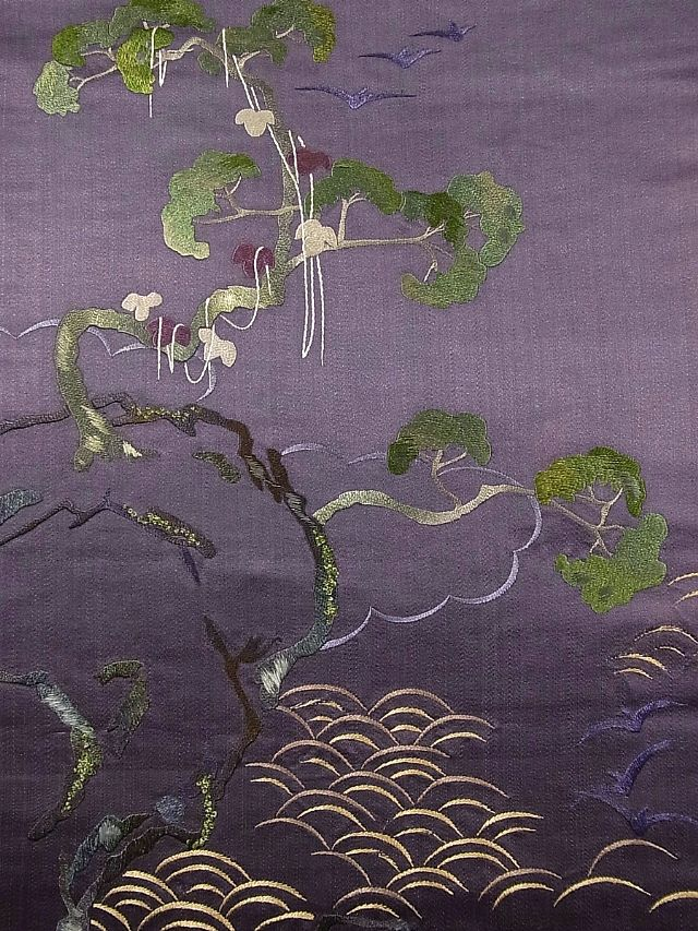 An unusual obi design of pine trees and waves. Ichiroya.