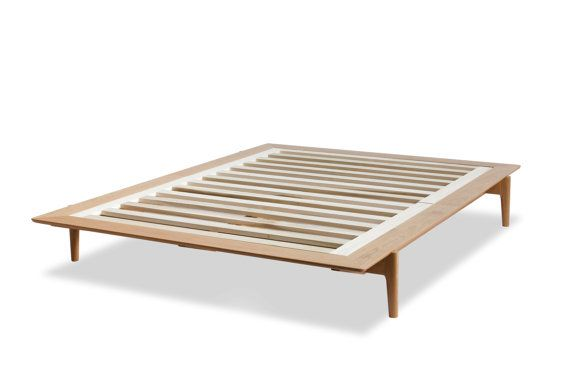 Simplicity at its best. This bed frame assembles with interlocking pieces and no additional hardware. Youll love the smooth lines and low profile of this platform bed. Assembles quickly and easily. Slat system included. Finished with a clear, matte varnish that provides durability and water resistance.  Pictured: White Oak, Queen Size Also Available: Cherry, Maple, Red Oak, Walnut  DIMENSIONS Full frame size : 59 Wide x 78 Long x 11 1/4 High Queen frame size : 64 W x 83 L x 11 1/4 H King…