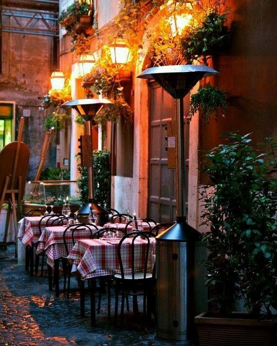 Sidewalk Dining in Rome, Italy.  America should have more of these quaint little outdoor cafe places.