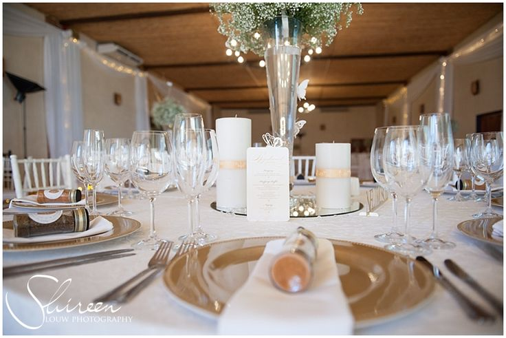 Table decor - tall vases with baby's breathe ball on top