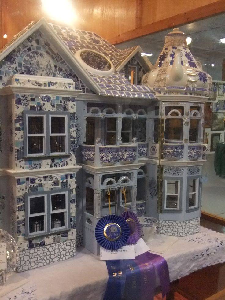 dollhouse made of blue and white porcelain mosaic