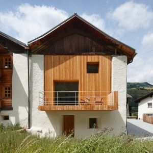 Baumhauer adds timber-lined living spaces to vernacular Swiss farmhouse