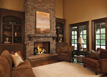 Full length cabinets flanking fireplace, stone and fireplace design/stone veneer, color of wall plaster.