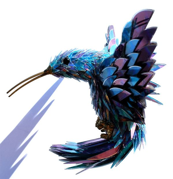 In his mixed media sculptures of animals and insects artist Sean Avery creates fur and feathers using meticulously layered fragments of broken CDs.  See more over on DeviantArt.