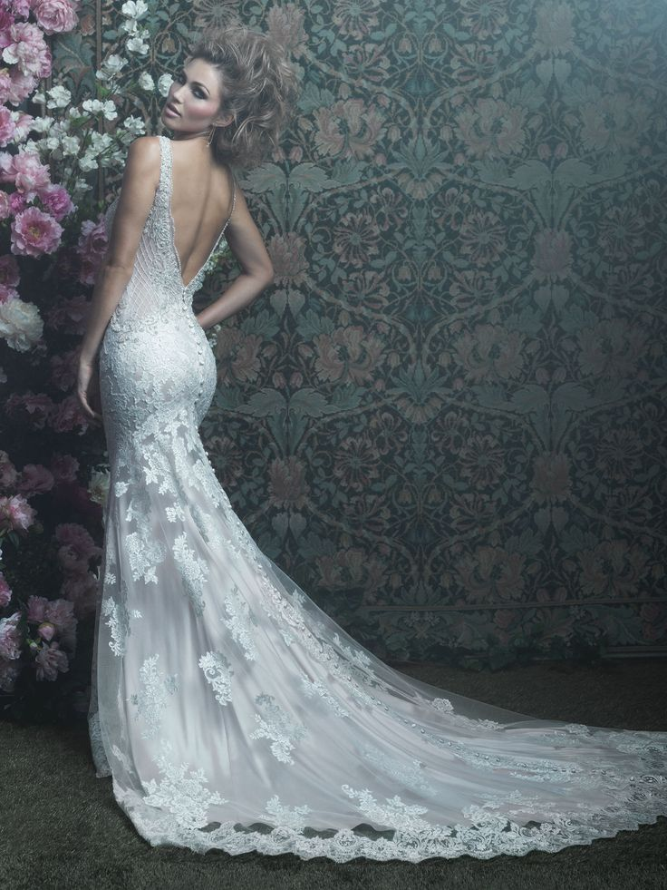 Style C412: This delicate sheath features a vintage appeal in a silky slip dress and a sheer lace-covered overlay. Found at Celebrations Bridal in St. Cloud, MN.