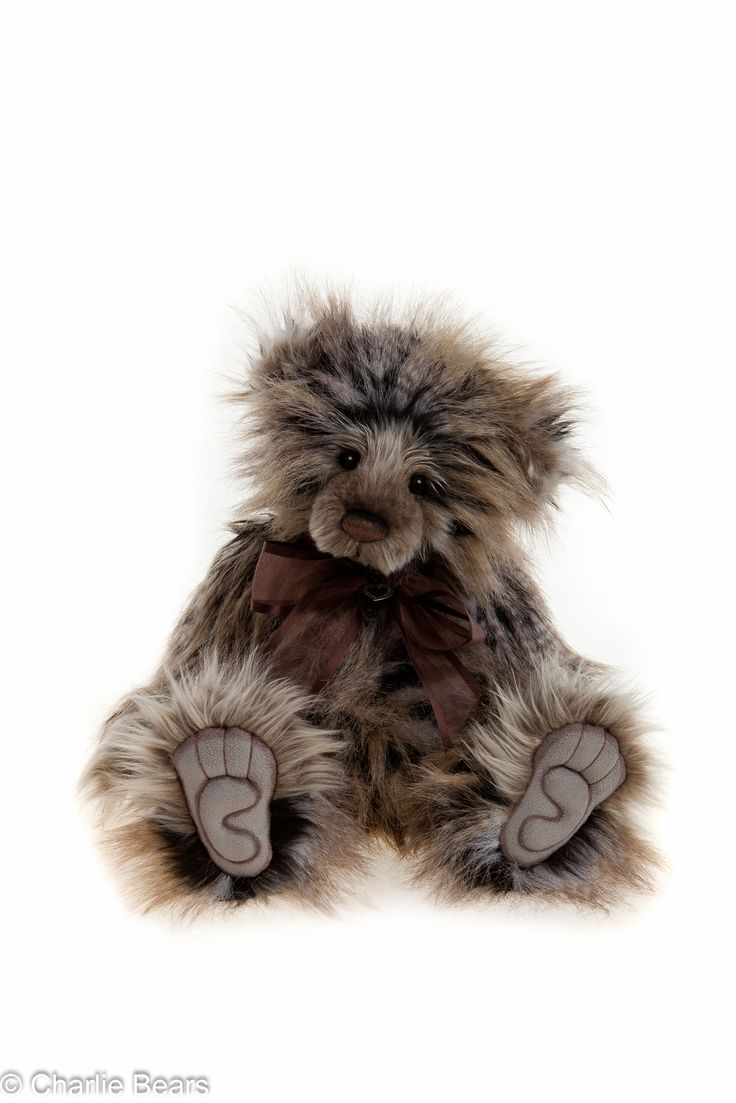 What a gorgeous bear, standing 41cms Charlie Year Bear 2015 is made from long, spotted fur. She has hand sculpted paw pads and a gorgeous expression. A plumo bear, Charlie Year Bear 2015 has a mohair muzzle and inner ears, she also wears a chocolate bow with a heart charm. Available from http://charlieteddybears.net/product/charlie-year-bear-2015/