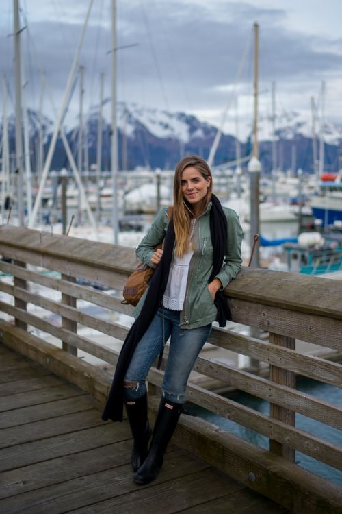 White cotton tee, mid-wash jeans, wellies, khaki jacket, black scarf, tan leather bag and relaxed hair and makeup. Gal Meets Glam in Alaska