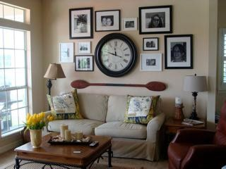 picture arrangement with clock mix pictures with other wall decor