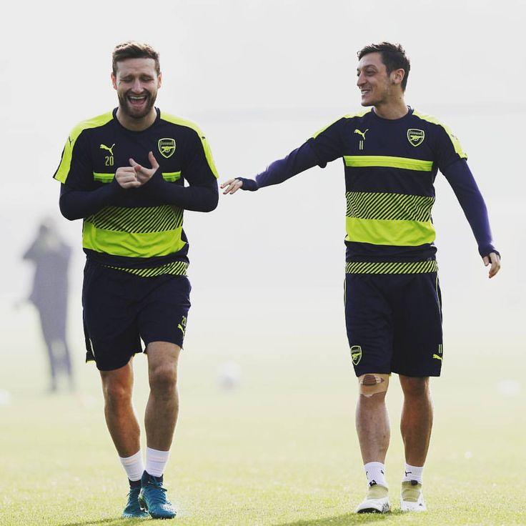 Shkodran Mustafi and Mesut Özil.