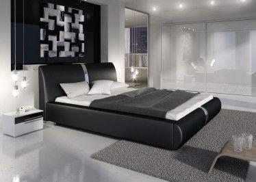 Tweepersoonsbed Rivalo is een luxe bed met chrome strips welke het hoofd- en voetenbord sieren. Dit model wordt geleverd met een gratis lattenbodem. Het gehele bed is gemaakt van kunstleer in zwarte kleur en geschikt voor matrasmaat 180 x 200 cm.