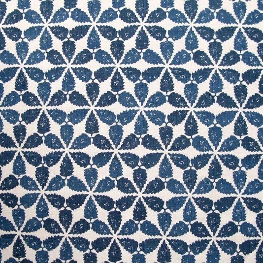 Maroc Fabric An eye-catching indigo fabric with a simplified motif taken from the tiled decoration of a courtyard in Fez. The inks have been blended by hand during the printing process resulting in a subtle variation of shades across the pattern. Designed, manufactured and printed in the United Kingdom.