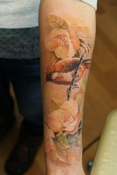Gorgeous flower sleeve watercolor tattoo on forearm for girls - bird tattoo