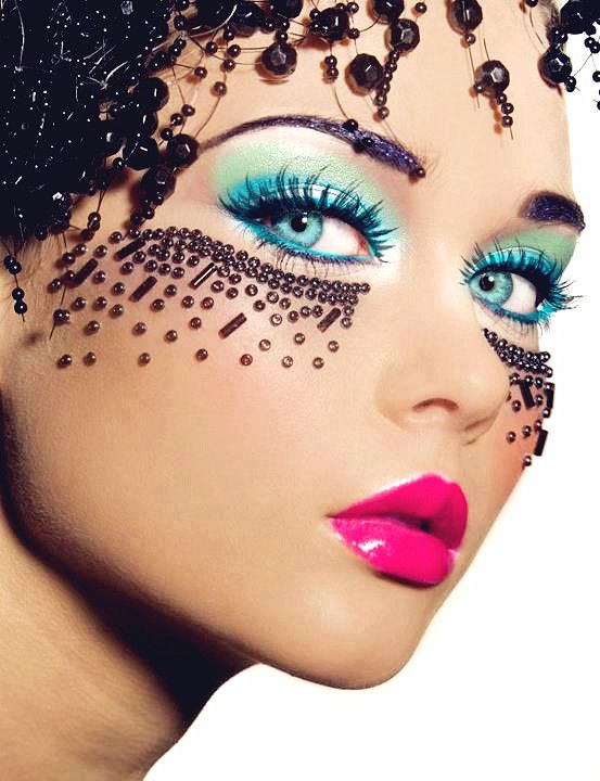 Middle sky blue/ turquoise eye shadow and liner, bright pink glossy lipstick. Bead decoration over cheeks and hair - very exotic.