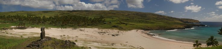 Panorama of Anakena, Easter Island with two Ahu: the one in the foreground has one Moai; the one in the background has several