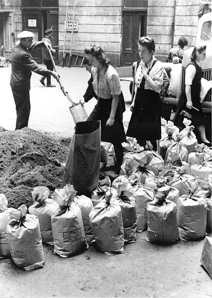 Warsaw Uprising: Filling of sand bags by civilian population in the courtyard of townhouse at Moniuszki 11 street - 1944