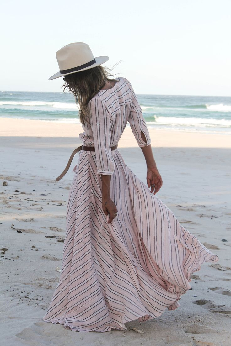 summer dress with a thin leather belt. White hats pop in almost any setting or with almost any outfit.