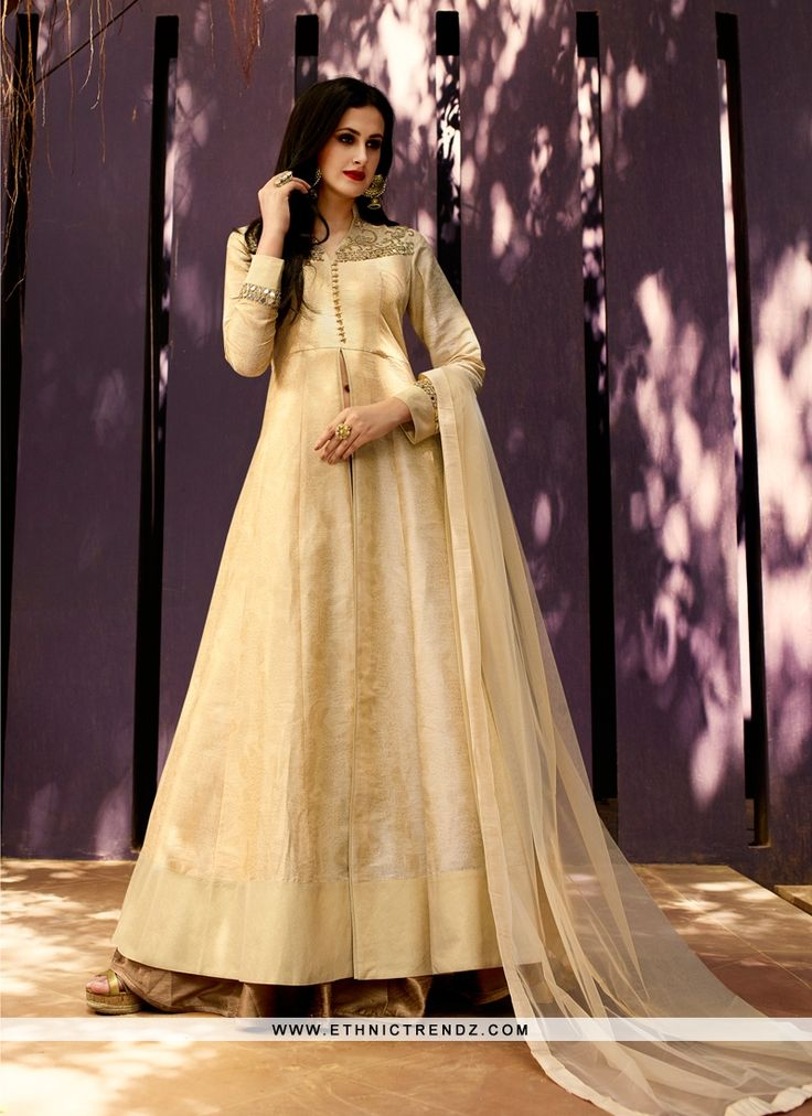 We are to breathe life into your aspirations and to make a mark in the world of style. You are sure to make a strong fashion statement with this beige jacquard silk designer lehenga choli. This attire...