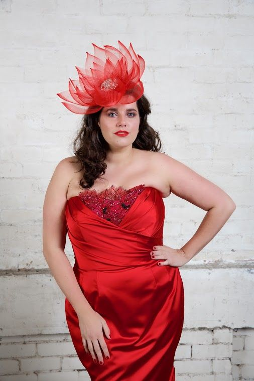 The striking FIELD OF ROSES gown, is a strapless fully corseted number, designed  to show off your feminine curves! Available in made to measure. All evening gowns are available for plus size ladies.  Head piece by The Essential Hat.
