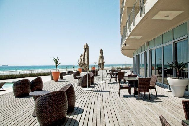 Lagoon Beach Hotel Deck over looking the beach, Cape Town Harbor and Table Mountain