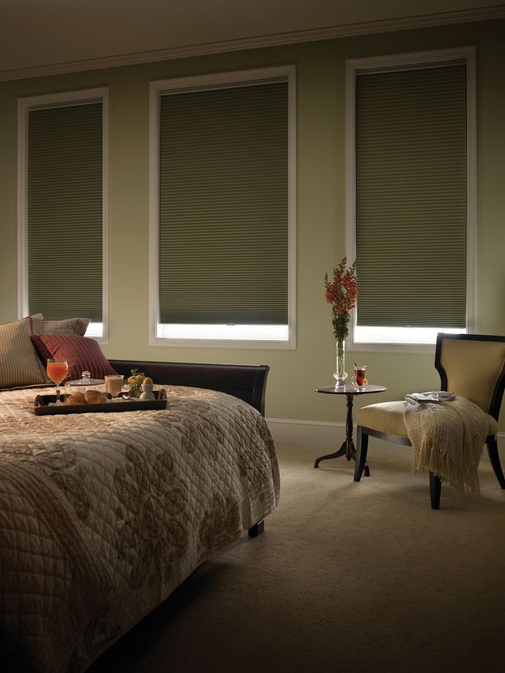 Remote controlled blackout cellular blinds are fantastic for media rooms and for day sleepers. Those high windows are now controlled. Just hit the remote to operate the shade up and down.