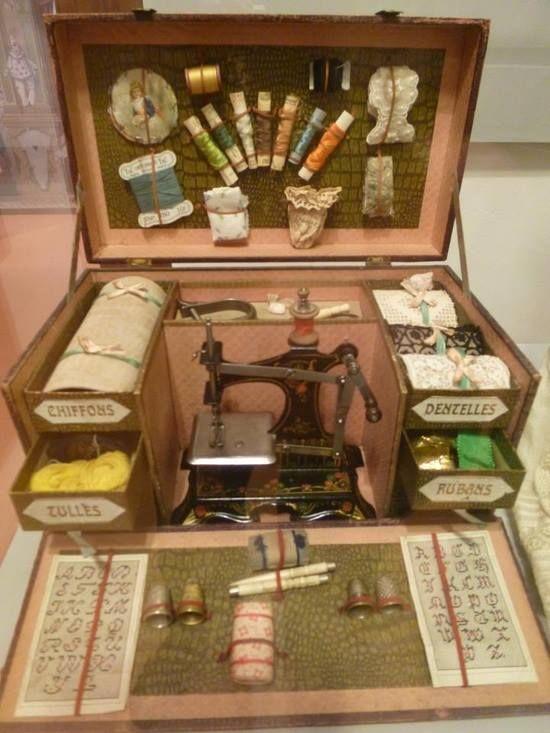 Beautiful antique sewing machine in sewing box.