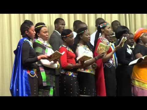 Brothers and sisters singing at the South African branch.