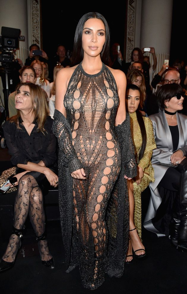 Kim Kardashian wearing a total see-through dress at Balmain Fashion Show in Paris - See more: http://www.mycelebrity.eu/kim-kardashian-see-through-dress-at-balmain-fashion-show/