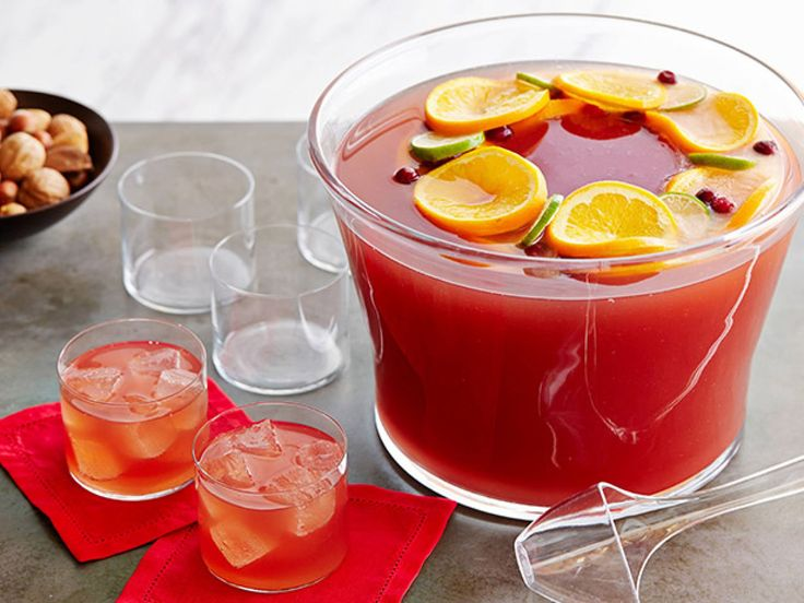 Cosmopolitan Fizz-Punch 101 : The Cosmopolitan, a '90s favorite, meets the '50s classic, ginger ale punch, in this tasty mashup. A gorgeous frozen fruit ring keeps the punch cold well into the night. If you can't find fresh cranberries, frozen will work too.