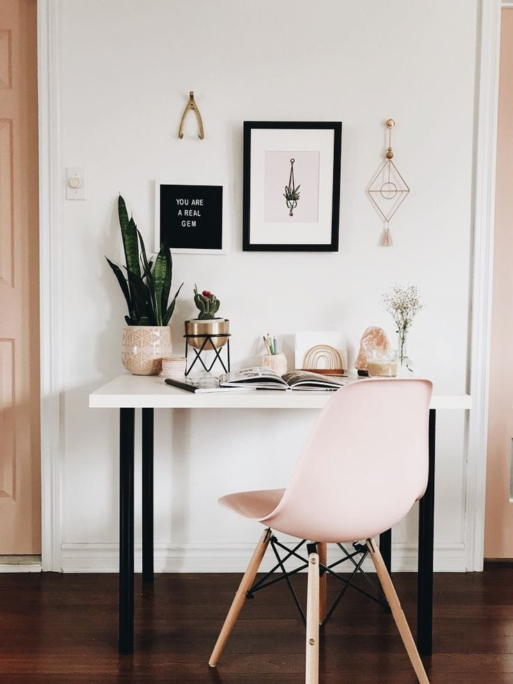 Minimalist home office decor in shades of pink, black and a touch of