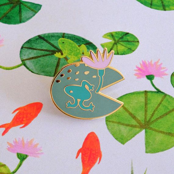 A luxury illustrated lapel pin badge in glossy hard enamel and gold finish. Made from original artwork by Stephanie Cole Design, this lily pad in greens and pink will bring a sweet touch to all outfits. Seen here pictured on my New Pad greeting card ©Stephanie Cole, 2018