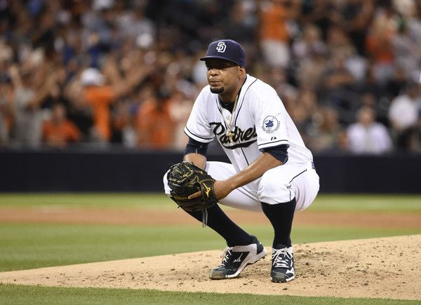 Odrisamer Despaigne Photos Photos - Odrisamer Despaigne #40 of the San Diego Padres crouches down on the mound after giving up a three-run home run during the fourth inning of a baseball game against the San Francisco Giants at Petco Park July 21, 2015 in San Diego, California. - San Francisco Giants v San Diego Padres