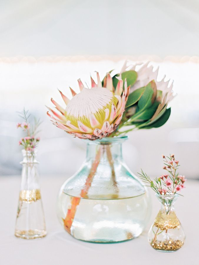 Protea centerpiece: http://www.stylemepretty.com/north-carolina-weddings/2017/03/15/from-a-beach-proposal-to-a-bohemian-garden-seaside-wedding/ Photography: Love by Serena - http://lovebyserena.com/ Assistance: Faith Teasley - http://www.faithteasley.com/