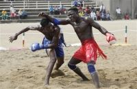 """Dambe-Since the 1950s, Nigerian boxers have held their own (and often far better than their own) in international boxing competition. Examples include Hogan """"Kid"""" Bassey (born Okon Bassey Asuquo), who won the world featherweight championship in 1957, and Dick Tiger (born Richard Ihetu), who won a succession of middleweight and light heavyweight boxing titles between 1962 and 1966."""