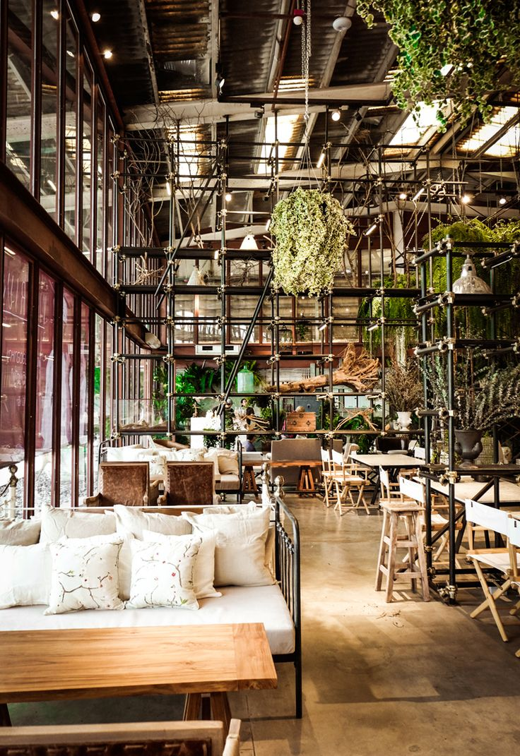 An converted warehouse is the setting for this Asian-fusion restaurant in Bangkok by young Thai design agency Hypothesis.