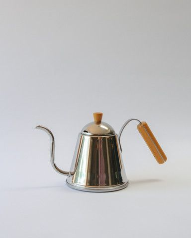 Coffee aficionados and design lovers unite as this striking kettle combines beauty and grace of form with the precision of function. The gentle sloped gooseneck spout delivers a steady stream of water