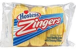 My all-time favorite packaged cake. Zingers! Made with spongy cakey goodness and filled with cream, then covered on top with delicious ice cream. It's a dream come true! Thanks you, dear Hostess, for coming back and once again serving this awesome delight!