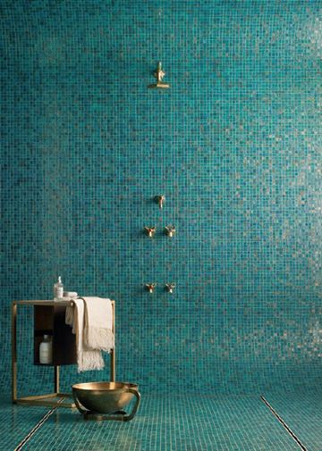 Aqua mosaic tiles and brass fittings
