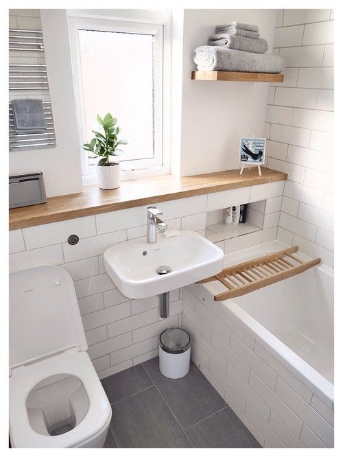 White tiles, wood, grey accents
