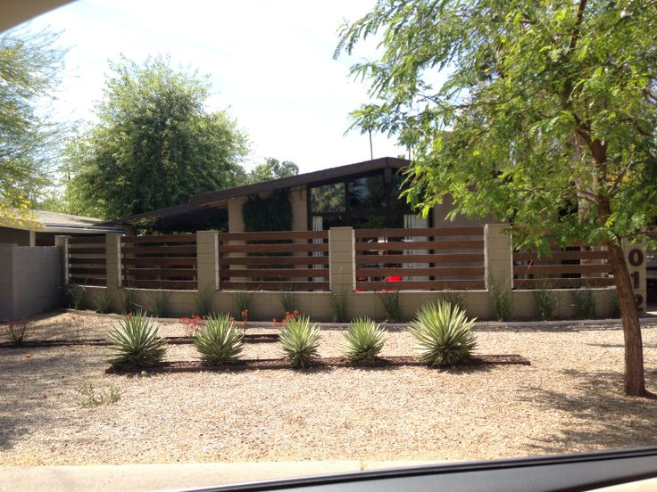 Trex and concrete block fence. Curved. partially open. Linear planter beds. #mcm #Haver #phoenix #curbappeal