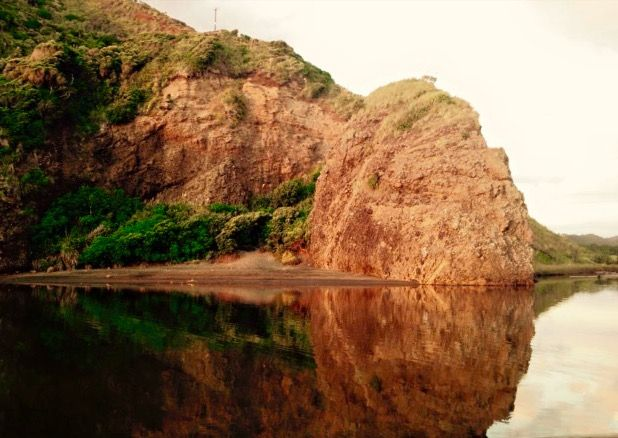 Bethell's Beach rock reflections . By Geeta Uka