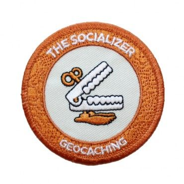 """7SofA Patch: The Socializer $4.00 USD  For you, is geocaching a group sport? Do you have a clever team name for your geo-crew and get a group selfie after every find? If you ruled the world, would all currency be converted to high-fives and fist bumps?  If this sounds like you or someone you know, celebrate with this cool Socializer patch!  Attend an Event Cache, Mega-Event or Giga-Event to unlock the Socializer souvenir.  Size: 2.5"""" (6.3cm) in diameter"""