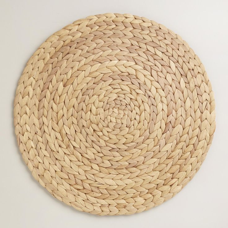 Our Natural Fiber Round Placemats will add a gorgeous eco-chic backdrop to your table setting. Skilled artisans in Vietnam transformed naturally harvested water hyacinth, which is famously sustainable for having the highest known growth rate of any plant, into the intricate woven designs that makes these placemats absolute treasures for your table.