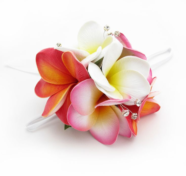Multi-coloured frangipani wristlet with diamantes. Find your perfect wedding flowers at http://www.loveflowers.com.au/