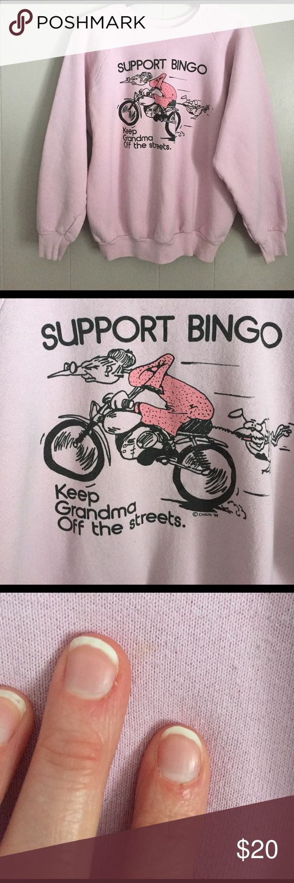 """Vintage Bingo Sweatshirt '88 """"Support Bingo-- Keep Grandma Off the streets ©CHAIN'88"""". Purplish pink crewneck sweatshirt. In good, vintage condition. I did notice one very small spot and it is shown in the picture. This cracks me up and I love a funky and random graphic shirt. It doesn't fit anymore so I've gotta find it a new home. Made by Fruit of the Loom, 50% cotton 50% polyester. Vintage Tops Sweatshirts & Hoodies"""