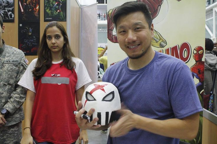 "Henrry Liao with the helmet of ""X"" cosplay."