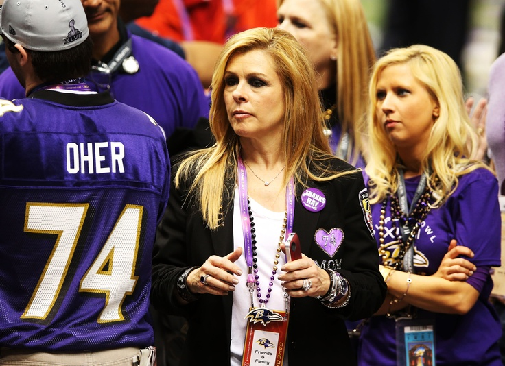 Michael Oher's family cheering him on towards his Super Bowl victory :) I love Leigh-Anne Tuohy. Isn't she just the greatest? -E