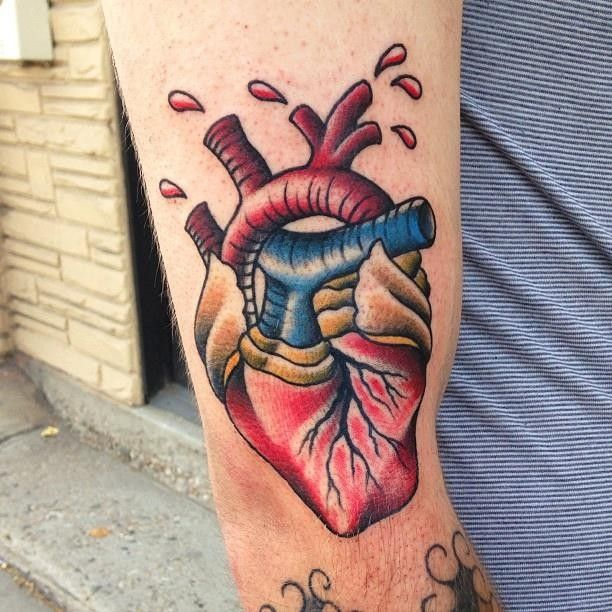Coloured american classic tattoo with wounded heart
